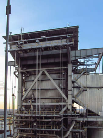 the upper part of the large steam boiler protruding above the roof of the power plant 版權商用圖片