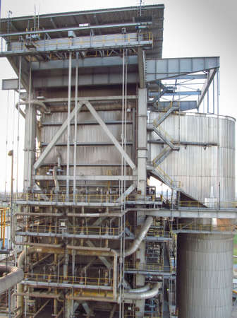 the upper part of the large steam boiler protruding above the roof of the power plant