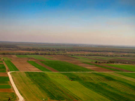 bird's eye view of colorful fields and meadows with a visible skyline, Serbia in the Balkans, Europe 版權商用圖片