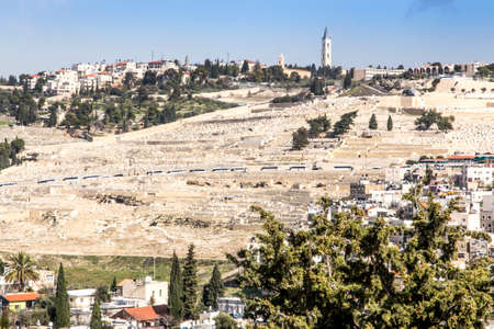 Dense buildings in one of the Jerusalem areas in Israel as a backdrop. The Mount of Olives is visible with one of the most expensive cemeteries in the world. 版權商用圖片