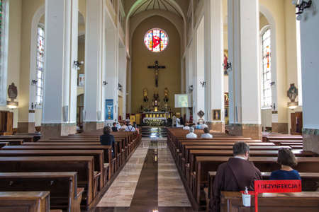Czestochowa, Poland, August 22, 2020: Interior of the Church of the Exaltation of the Holy Cross in Czestochowa. In the foreground, the place where hands were disinfected during the Covid-19 epidemic.