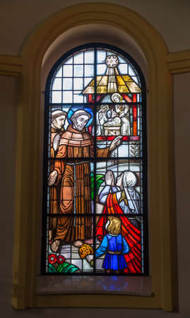Kalety Miotek, Poland, April 7, 2020: Stained glass window in the church of St. Francis of Assisi in Miotek in Silesia in Poland. Saint Francis in the foreground