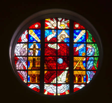 Czestochowa, Poland, August 22, 2020: Colorful stained glass window above the main altar in the Church of the Exaltation of the Holy Cross in Czestochowa 新聞圖片