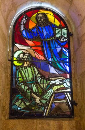 BETHLEHEM, Palestine, January 28, 2020: Caves under the Basilica of the Nativity in Bethlehem. Stained glass window commemorating Saint Jerome 新聞圖片
