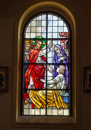 Kalety Miotek, Poland, April 7, 2020: Stained glass window in the church of St. Francis of Assisi in Miotek in Silesia in Poland. The resurrection of the youth of Nain