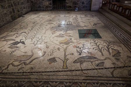 Tabgha, Israel, January 27, 2020: The Church of the Multiplication of the Loaves and the Fishes with the famous mosaic on the floor.