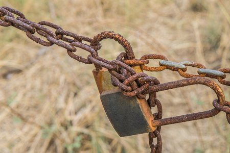 break chain: old lock and rusty chain