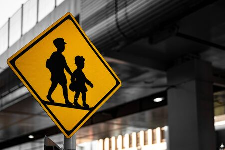 Children's signboard across the road with cityscape backgrounds