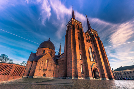 December 04, 2016: Front of the Cathedral of Saint Luke in Roskilde, Denmark Stock Photo