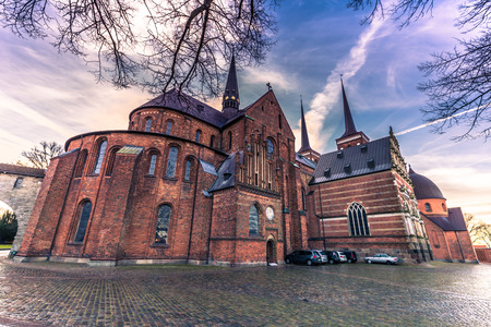 reformation: December 04, 2016: Sideview of the cathedral of Saint Luke in Roskilde, Denmark