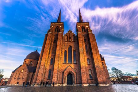December 04, 2016: Frontal view of the Cathedral of Saint Luke in Roskilde, Denmark Stock Photo