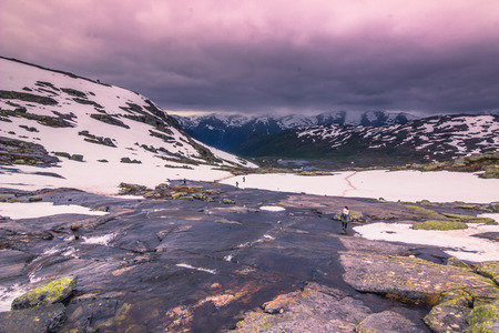 July 22, 2015: Traveller on the hiking path to Trolltunga, Norway Stock Photo