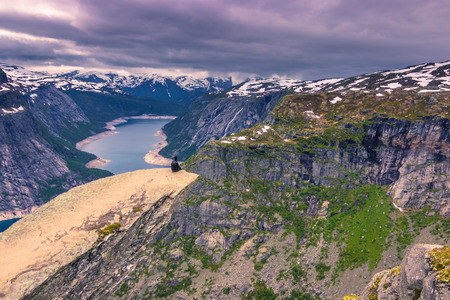 July 22, 2015: Traveller at the edge of Trolltunga, Norway