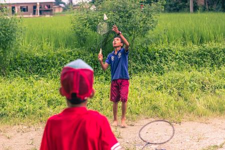 nepali: August 26, 2014 - Kids playing badminton in Sauraha, Nepal Editorial
