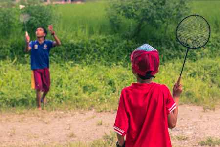 August 26, 2014 - Kids playing badminton in Sauraha, Nepal Editorial