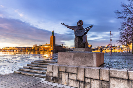 Statue of a musician by the city hall of Stockholm, Sweden
