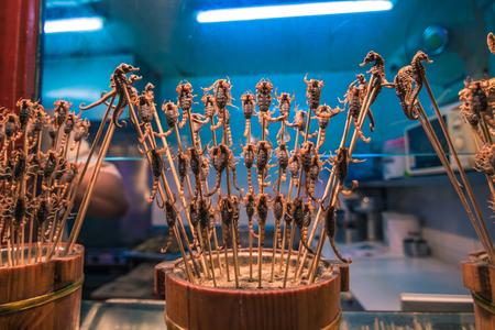 Beijing, China - July 19, 2014: Fried scorpions in the Night food market of Wangfujing