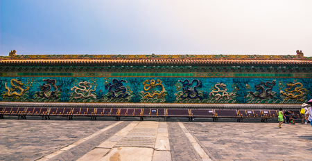 Beijing, China - July 20, 2014: Nine dragon wall of the Forbidden City Editorial