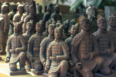 Xian, China - July 22, 2014: Miniatures of terracota warriors at the tombs of the Terracota Army Editorial