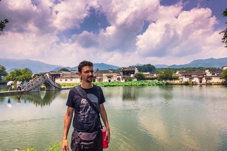 Hongcun, China - July 28, 2014: Traveller in the village of Hongcun Editorial