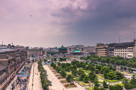 Xian, China - July 22, 2014: Bell tower seen from the Drum Tower of Xian Editorial