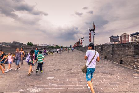 Xian, China - July 23, 2014: Tourists in the ancient walls of Xian