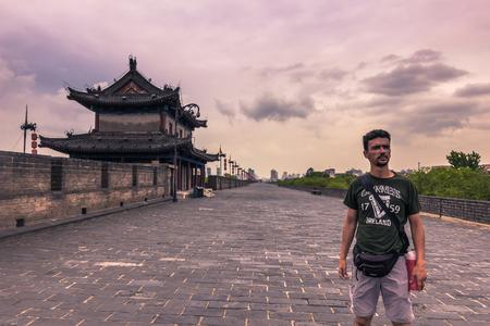 Xian, China - July 23, 2014: Tourist in the ancient walls of Xian Editorial