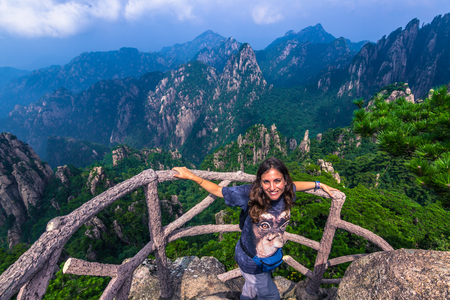 Huangshan, China - July 29, 2014: Traveller at the peak of the Yellow Mountains