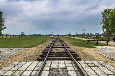 Auschwitz , Poland - May 14, 2016: Train tracks in Auschwitz Birkenau Concentration camp, Poland