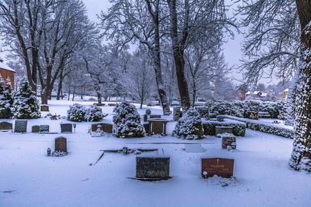 sweden winter: December 10, 2016: Tombstones in a cemetery in Sigtuna in winter, Sweden