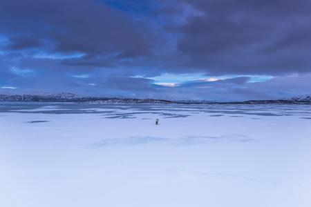 Lapland, Sweden - January 30, 2014: Lone traveler in Abisko National Park, Sweden
