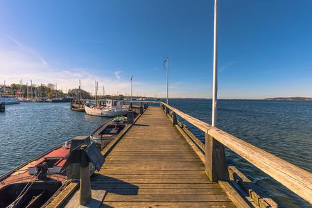 Roskilde, Denmark - May 01, 2017: Viking long boats in the harbor of Roskilde