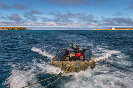 Galapagos Islands - August 24, 2017: Boat riding on the coast of Santa Cruz island, Galapagos Islands, Ecuador