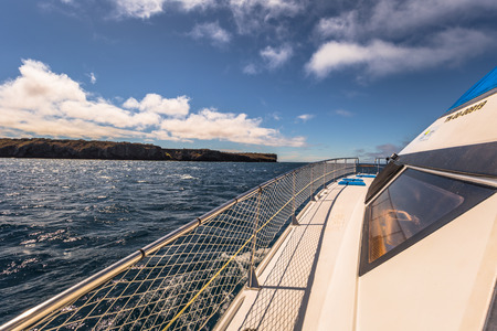 sur: Galapagos Islands - August 24, 2017: Boat riding on the coast of Santa Cruz island, Galapagos Islands, Ecuador