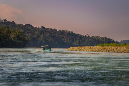 Manu National Park, Peru - August 06, 2017: Tour boat in the amazon rainforest of Manu National Park, Peru