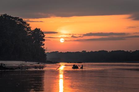 Manu National Park, Peru - August 09, 2017: Sunrise in the Amazon rainforest of Manu National Park, Peru Editorial