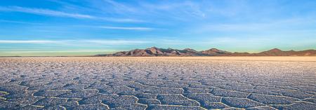 Landscape of the Uyuni Salt Flats at sunrise, Bolivia Stock Photo