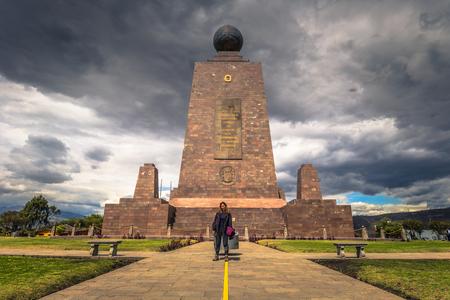 Mitad del Mondo - August 21, 2018: Tourist in the Middle of the World monument in Mitad del Mondo, Ecuador