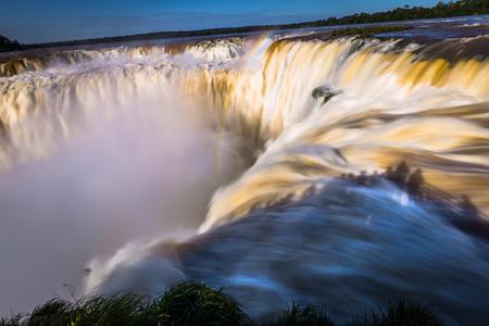 Puerto Iguazu - June 24, 2017: The Devil's Throat site at the Iguazu Waterfalls, Wonder of the world, at Puerto Iguazu, Argentina