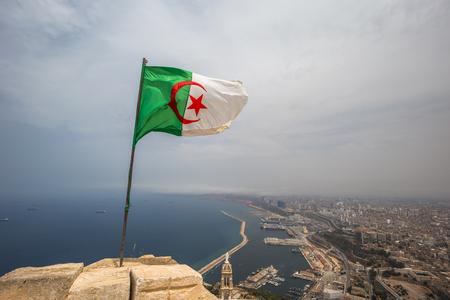 The Algerian flag overlooking the city of Oran, Algeria Stok Fotoğraf - 97683795