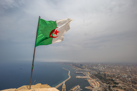 The Algerian flag overlooking the city of Oran, Algeria Stok Fotoğraf - 97686571