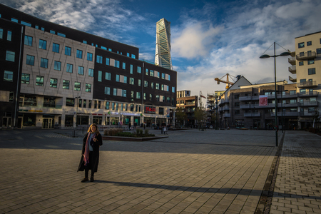 Malmo - October 22, 2017: Walking to the Turning Torso building in Malmo, Sweden Editorial