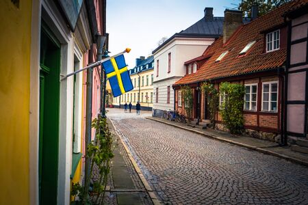 Lund: The Swedish national flag in the historic center of Lund, Sweden Stock Photo