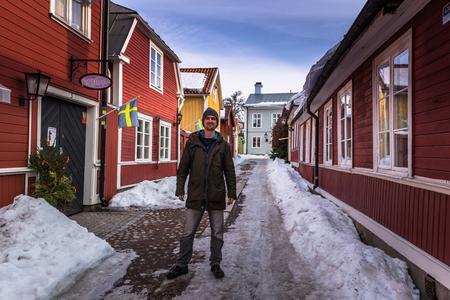 Gavle - April 01, 2018: Traveler at the historic center of the town of Gavle, Sweden Editorial