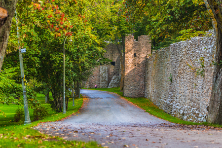 Visby - September 23, 2018: Quiet path by the old fortress walls of Visby in Gotland, Sweden