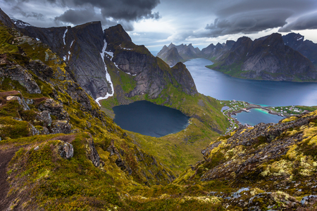 Panoramic view of the fishing town of Reine from the top of the Reinebringen viewpoint in the Lofoten Islands, Norway Stock Photo