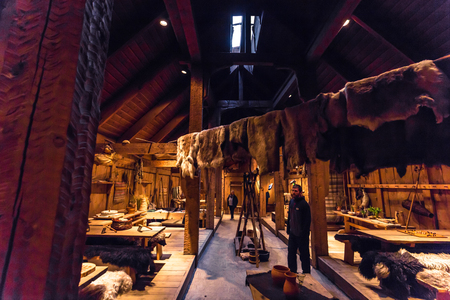 Borg - June 15, 2018: Inside the Viking Longhouse in the Lofotr Viking Museum at the town of Borg in the Lofoten Islands, Norway