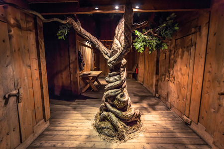 Borg - June 15, 2018: Recreation of the Viking tree Yggdrasil Inside the Viking Longhouse in the Lofotr Viking Museum at the town of Borg in the Lofoten Islands, Norway