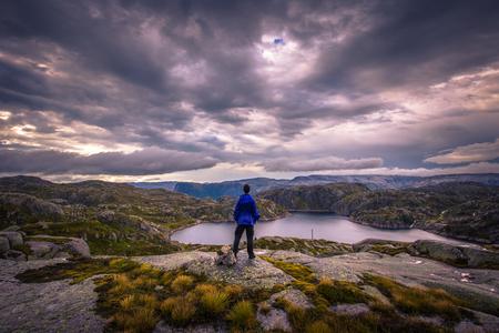 Norway- July 31, 2018: Traveler in the landscape near the Kjerag rock, Norway Editorial