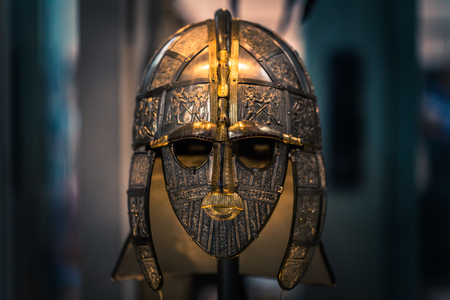London - August 06, 2018: Replica of an ancient Anglo-Saxon helmet in the Brtitish Museum in London, England Редакционное